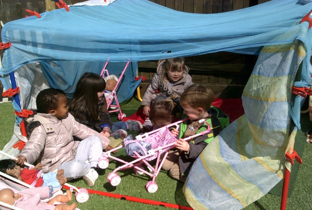 Popsy (3), Natasha (4), Olivia (3), Sklya (2) and Riley (2) playing in a den they made at nursery