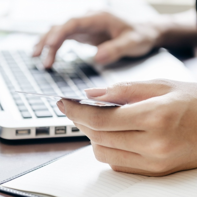 Laptop computer typing on keyboard wifi online digital library