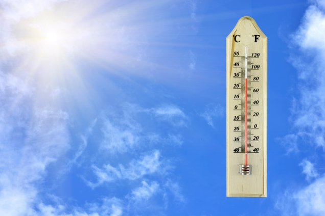 thermometer on wood plate blue sky background