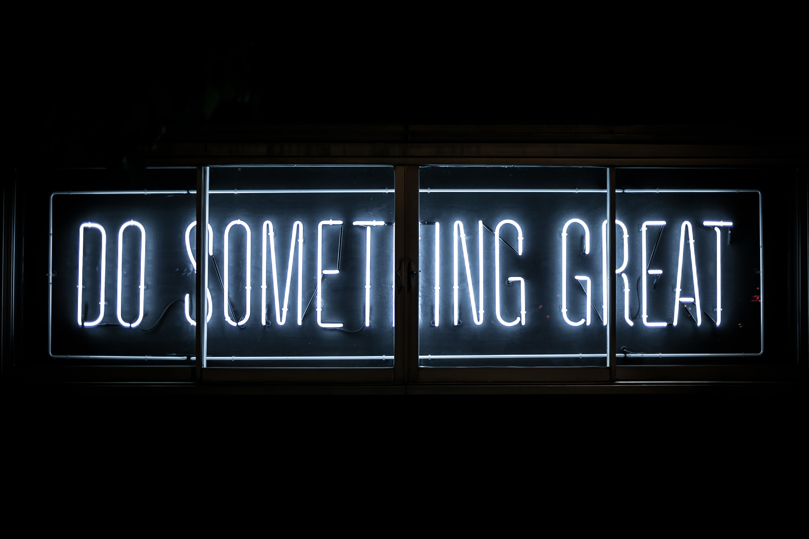 Photo of neon sign saying 'Do Something Great'