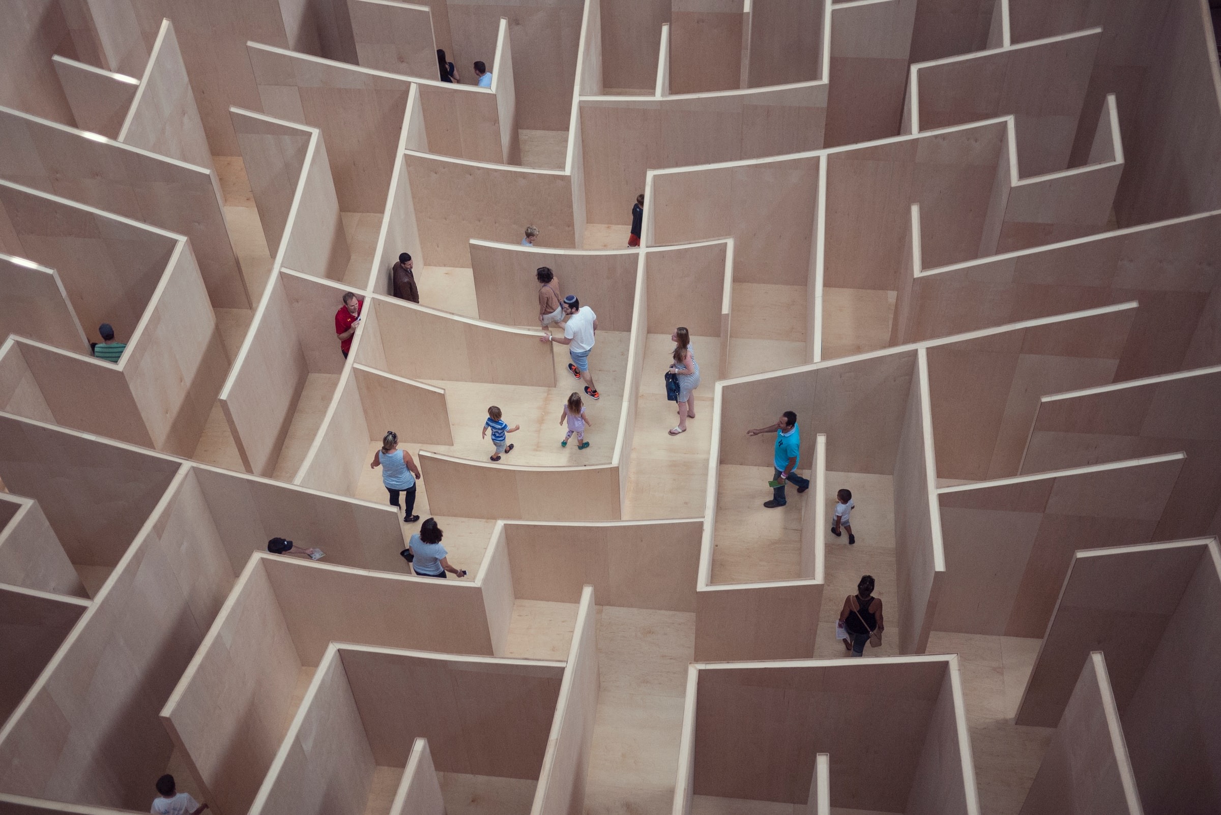 Photo of people walking in maze