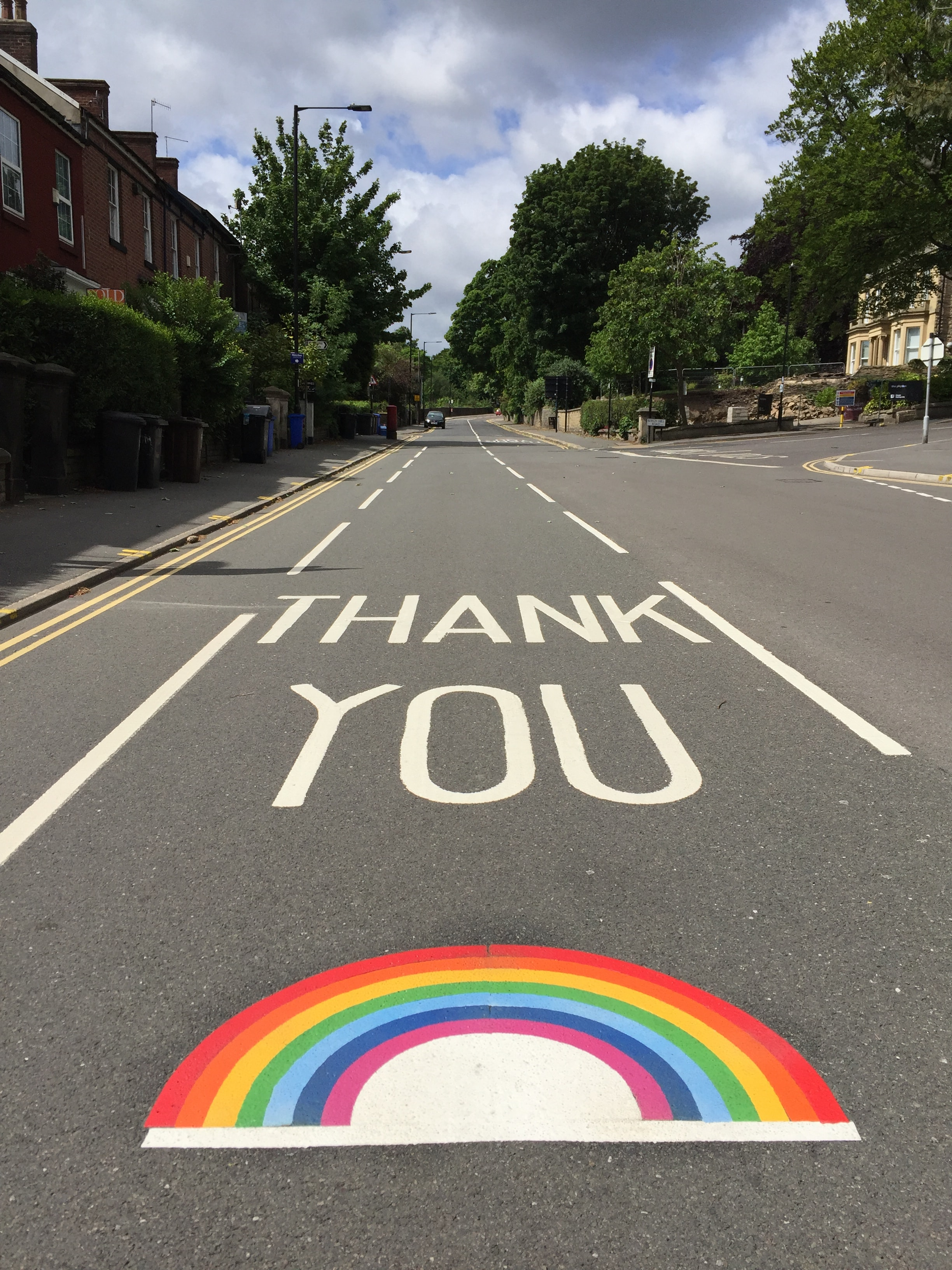 Thank You painted on road